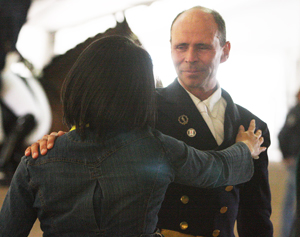 A tearful Steffen Peters with Akiko Yamazaki, owner of Ravel, after the FEI World Cup Final Grand Prix. Photo: Ilse Schwarz