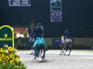 Top placegetters in FEI World Cup Final Grand Prix scattering at the approach of US standard bearer. Photo: Ken Braddick
