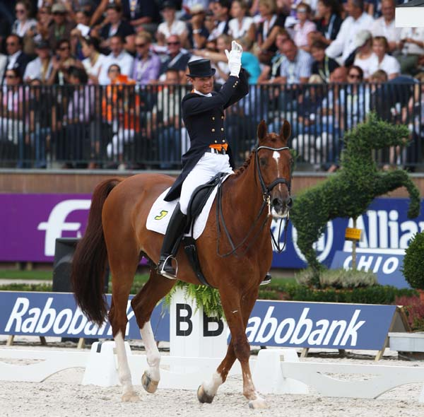 Adelinde Cornelissen and Jerich Parzival capturing individual gold medal at the 2011 European Championships. ©2011 Ken Braddick/dressage-news.comed