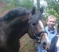 John Byrialsen with the breeding stallion Come Back II that he owns.