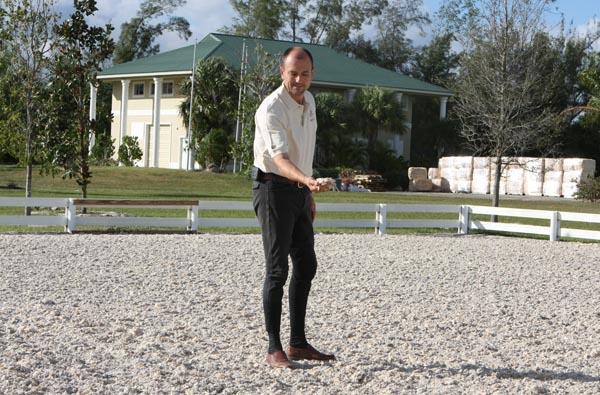 Lars Petersen checking riding surface at Equestrian Estates dressage grounds. © Ken Braddick/dressage-news.com