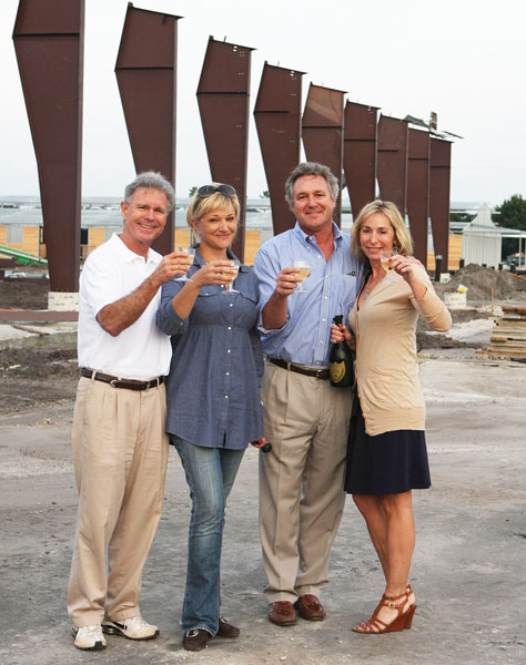 Kimberly Boyer (in blue) with Wellington Equestrian Partners Roger Smith (left) and Mark and Katherine Bellissimo toasting the first steel beams of the Van Kampen Arena at the Global Dessage Festival grounds in 2012. © Ken Braddick/dressage-news.com