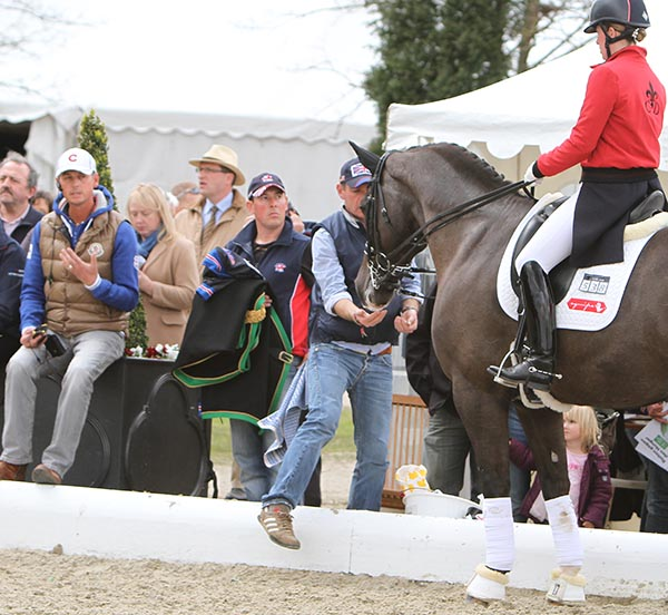 Carl Hester (gold vest) coaching Charlotte Dujardin on Valegro at Hagen, Germany where the pair set a world record Grand Prix Special score. © 2012 Ken Braddick/dressage-news.com