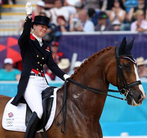 Great Britain's Laura Tomlinson (riding as Behctolsheimer before her marriage) in tears as she completed her Grand Prix Freestyle on Mistral Hojris at the London Olympics. © 2012 Ken Braddick/dressage-news.com