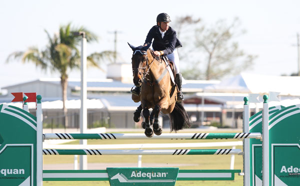 Charles Jacobs on Leap of Joy riding Sunday at the Palm Beach International Center's Stadium complex made up of the grass derby field and the Global Dressage Festival grounds. He has filed suit in Circuit Court to have the Stadium facility torn down that incldues the dressage barn in the background. The lawsuit also asked the court to undo an agreement between the horse show organizers and the Village of Wellington allowing events to be held there this winter, such as Sunday's $50,000 CSI2* in which he competed. ©2013 Ken Braddick/dressage-news.com