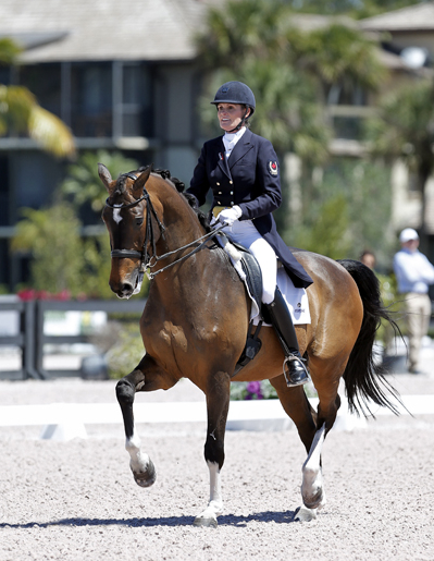 Ashley Holzer riding Breaking Dawn at a national show in Wellington. © 2013 SusanJStickle.com