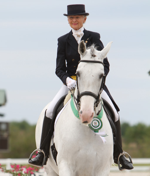 Janne Rumbough on Junior, a horse she bred, after competing in the World Cup Grand Prix to complete progression through all the United States training levels. ©2013 Ken Braddick/dressage-news.com  through Aerica