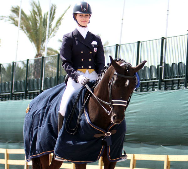 Caroline Roffman and Sagacious HF celebrating the CDI5* Young Rider Grand Prix. © 2013 Ken Braddick/dressage-news.com