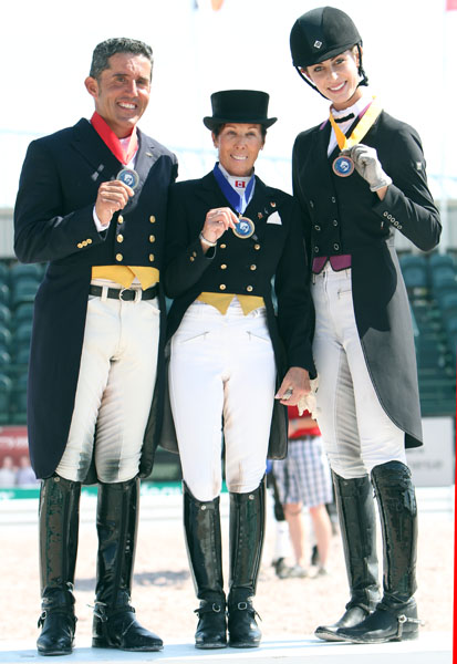 Christilot Boylen (center) won individual gold, Cesar Parra (left) took silver and Caroline Roffman bronze at the Wellington Nations Cup CDIO3*. © 2013 Ken Braddck/dressage-news.com