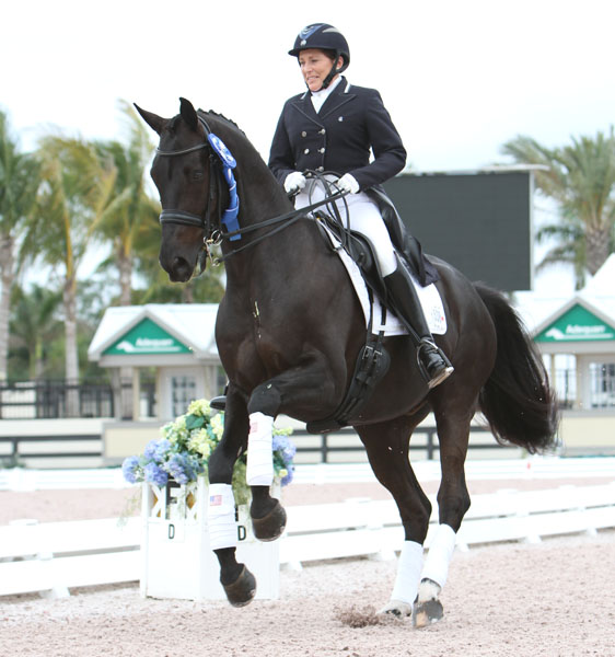 Shelly Francis on Danilo celebrating victory in the small tour at the Global Dressage Festival Wellington 5*. © 2013 Ken Braddick/dressage-news.com