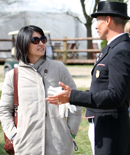 Akiko Yamazaki being briefed by Steffen Peters at Hagen. © 2013 Ken Braddick/dressage-news.com