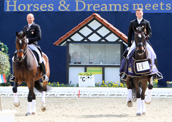 Steffen Peters on Legolas and Andreas Helgstrand on Akeem Foldager in victory gallop at Hagen CDI4* Grand Prix. © 2013 Ken Braddick/dressage-news.com