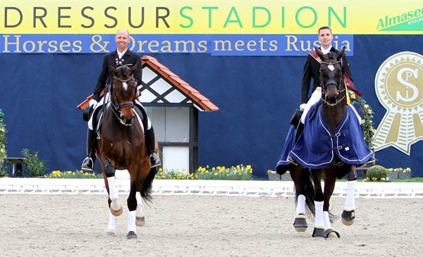 Steffen Peters on Legolas and Andreas Helgstrand on Akeem strutting their stuff in the victory gallop after the Grand Perix Freestyle. © 2013 Ken Braddick/dressage-news.com