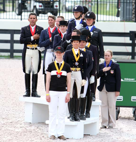 Nations Cup teams on the medals podium at the 2013 Wellington CDIO3*. © 2013 Ken Braddick/dressage-news.com