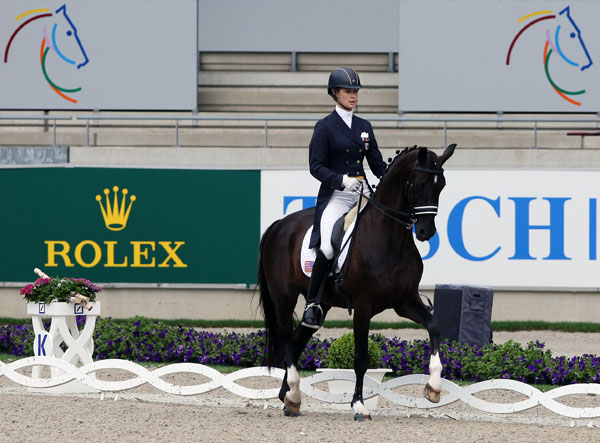Caroline Roffman competing Sagacious HF as the first American combination ever to ride in the World Equestrian Festival's Under-25 Division at Aachen, Germany. © 2013 Ken Braddick/dressage-news.com