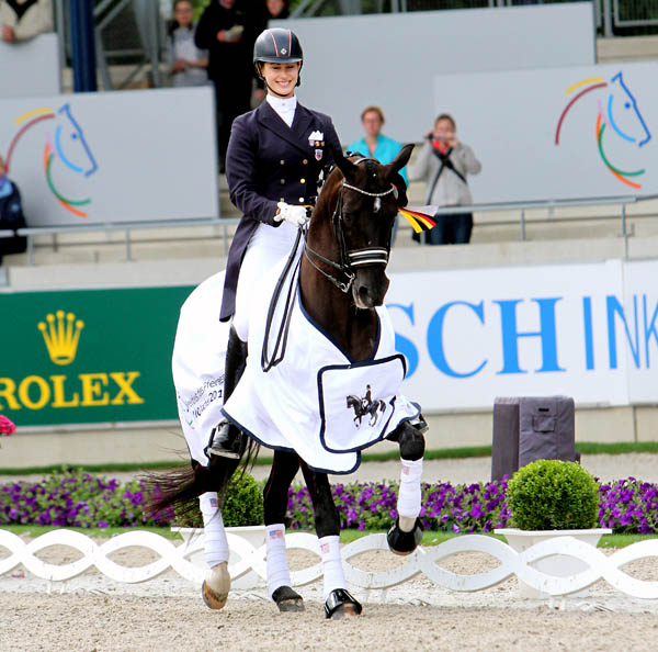 Caroline Roffman in the victory parade for the Under-25 Division at the World Equestrian Festival in Aachen, Germany. © 2013 Ken Braddick/dressage-news.com