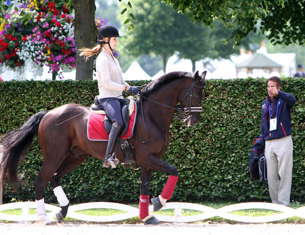 Caroline Roffman working Sagacious with help from U.S. team coach Robert Dover at Aachen, Germany. © 2013 Ken Braddick/dressage-news.com