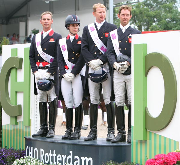 The Nations Cup winning team from Great Britain--Carl Hester, Charlotte Dujardin, Gareth Hughes and Daniel Watson on the medals podium. © 2013 Ken Braddick/dressage-news.com