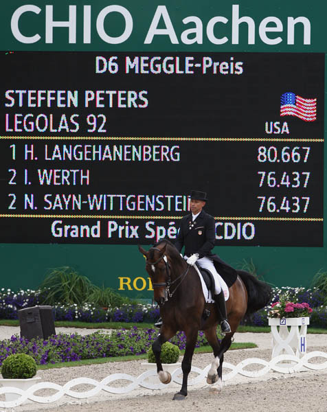 Steffen Peters and Legolas at the CDIO5* World Equestrian Festival performing their first Grand Prix Special outside California. © 2013 Ken Braddick/dressage-news.com