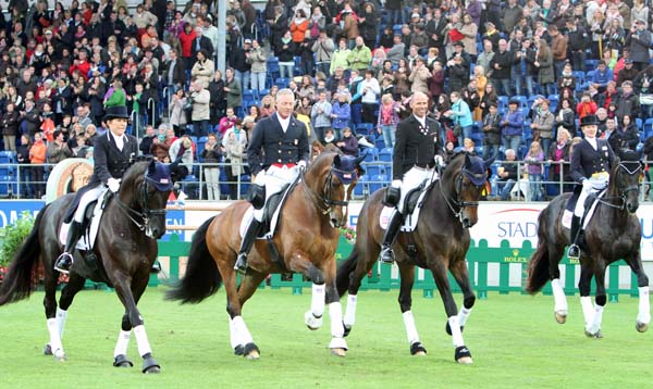 USA dressage team celebrating their third place finish at the World Equestrian Festival Nations Cup before a crowd of 45,000 spectators in the main arena at Aachen, Germany. ©2013 Ilse Schwarz/dressage-news.com