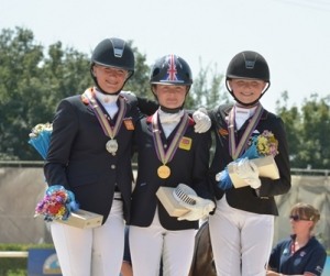 European Pony Champion Freestyle and Indivifusl gold medalist Phoebe Peters (center) of Great Britain with the Netherlands' Lisanne Zoutendijk (Freestyle silver) and Semmieke Rothenberg of Germany (bronze). © 2013 Arezzo Equestrian Center/Digital World