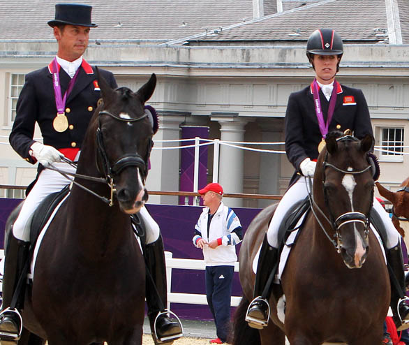 Carl Hester on Uthopia and Charlotte Dujardin on Valegro with Olympic team gold medals at London. © 2012 Ken Braddick/dressage-news.com