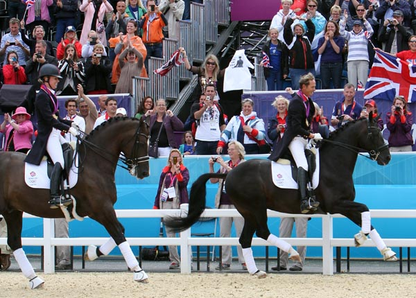 "Great Britain's dressage ""golden couple"" of Charlotte Dujardin on Valegro and Carl Hester in Uthopia celebrating the nation's first ever Olympic dressage medal at the 2012 London Games. © Ken Braddick/dressage-news.com"