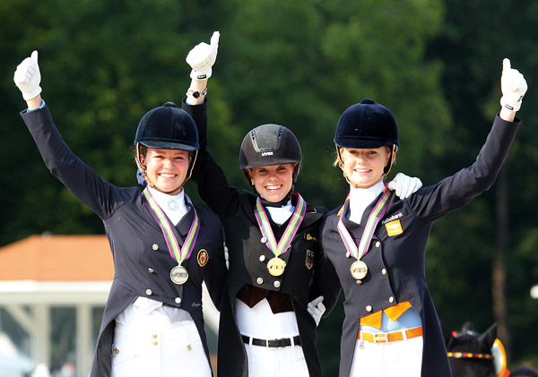 Johanne Pauline von Danwitz (center), the German Junior rider who won three gold medals at the European Championships.