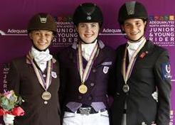 Junior Dressage Individual Medalists Rison Naness, bronze; Lindsey Hollegar, gold, and Naima Moreira Laliberte sIlver. ©2013 SusanJStickle.com