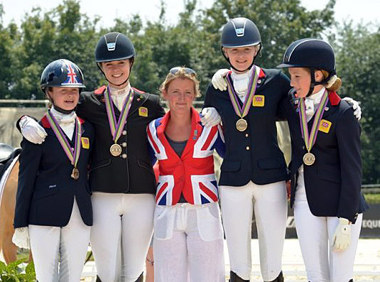 Great Britain's European Pony Championship team showing the flag like their grownu compatriots at the London Olympics a year ago. © 2013 Arezzo Equestrian Center/Digital World