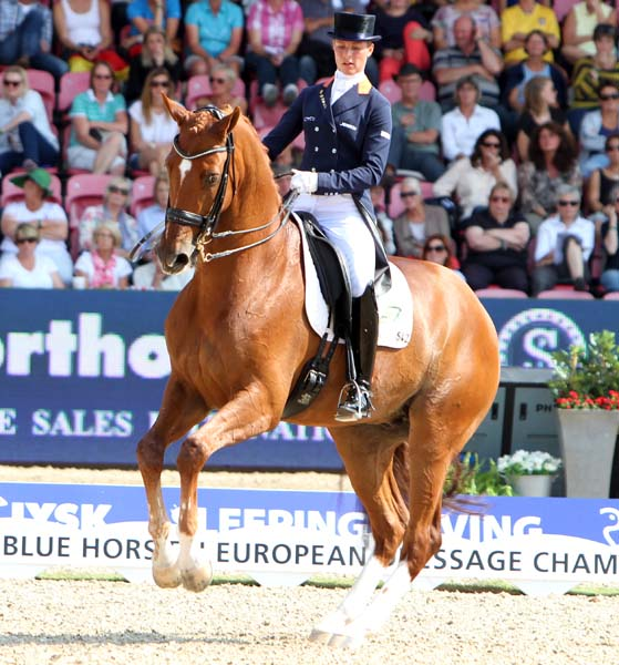 Adelinde Cornelissen who said she was with happy with her bronze medal because she thought she might never be able to ride Jerich Parzival again after being diagnosed with a heart condition. ©2013 Ken Braddick/dressage-news.com