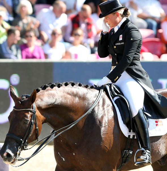 Anna Kasprzak and Donnperignon, the best of the new generation of Danish riders, was brought to tears by cheers and applause of the crowd. He mother's business, Ecco, was the sponsor of the dressage, jumping and para-dressage championships. ©2013 Ken Braddick/dressage-news.com
