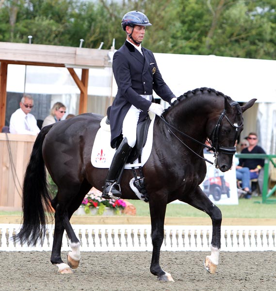 Carl Hester riding Uthopia in the Hickstead Nations Cup Grand Prix. The pair will lead Great Britain in the Freestyle that will determine the winner of the Nations Cup. ©2013 Ken Braddick/dressage-news.com