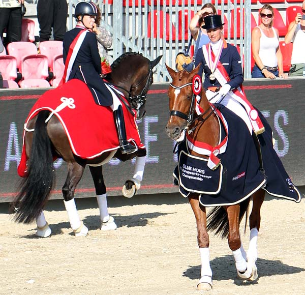 Er, wrong way, Adelinde and Parzival. The 16-year-old KWPN gelding wanted nothing to do with the traditional celebratory victory gallop and headed for the exit. Not so Valegro who seems to love the limelight. © 2013 Ken Braddick/dressage-news.com