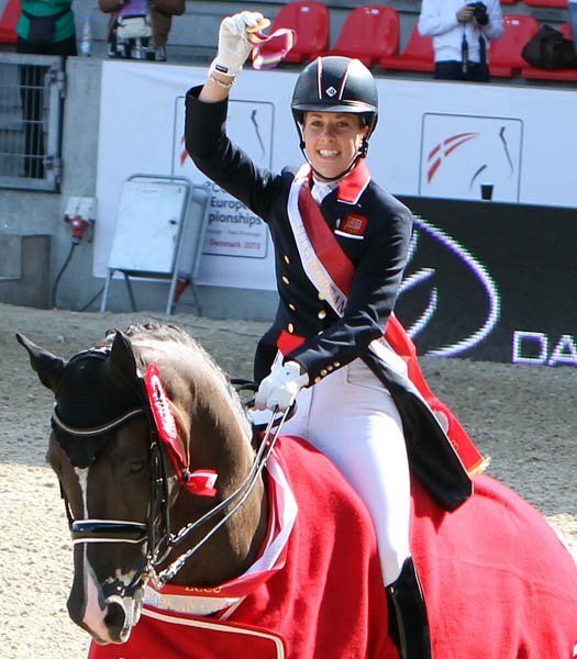 Charlotte Dujardin on Valegro with the gold medal for the European Championship Grand Prix Special. © 2013 Ken Braddick/dressage-news.com