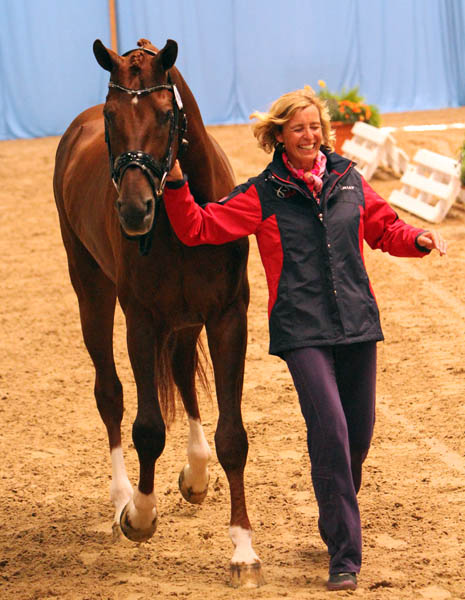 Charlotte Jorst with Vitalis enjoying her first World Young Horse Chamionship veterinary check. The air is the sole representative of the United States in the championships. © 2013 Ken Braddick/dressage-news.com