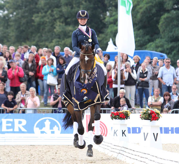 Sa Coeur ridden by Eva Möller of Germany repeating  as World Young Horse champion by winning gold medal as 6-year-old. ©2013 Ken Braddick/dressage-news.com