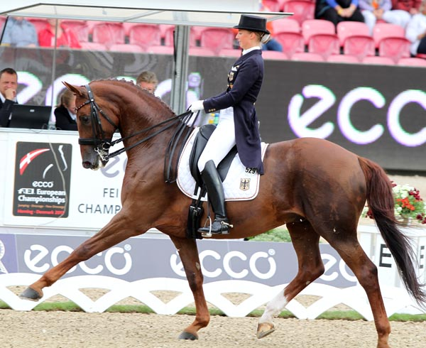 Fabienne Lütkemeier and D'Agostino that got Germany off to the lead after the first of two days of the Grand Prix team competition at the European Championships. © 2013 Ken Braddick/dressage-news.com