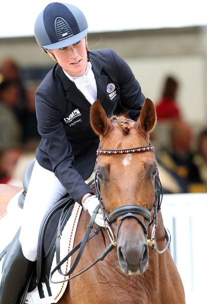 It's OK. Damon's Satellite leavingthe arena with Helen Langehanenberg. © 2013 Ken Braddick/dressage-news.com
