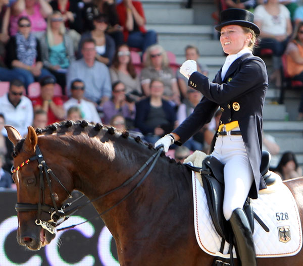 Guess what Helen Langehanenberg says after she goes off course in the European Championships Grand Prix Special. ©2013 Ken Braddick/dressage-news.com