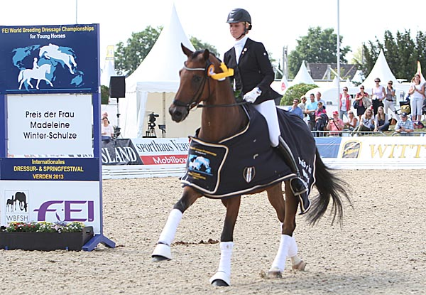 Laura Stigler and Doubleyou W celebratng victory in the 6-Year-old World Young Horse Championship qualifier. © 2013 Ken Braddick/dressage-news.com