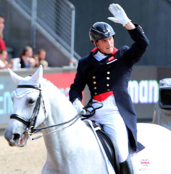 Michael Eilberg on Half Moon Delphi after his Freestyle that drew loud applause from the crowd that brough the first smiles to his face after anbeing the unsought center of a judging controversy. © 2013 Ken Braddick/dressage-news.com