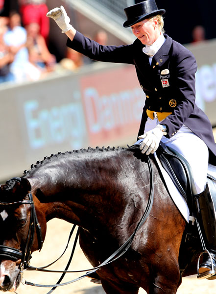Nathalie zu Sayn-Wittgenstein, unable to hold back tears as the crowd gives a standing ovation to Digby at the horse's championship retirement ceremony at the Europeans in Herning, Denmark last year. © 2013 Ken Braddick/dressage-news.com