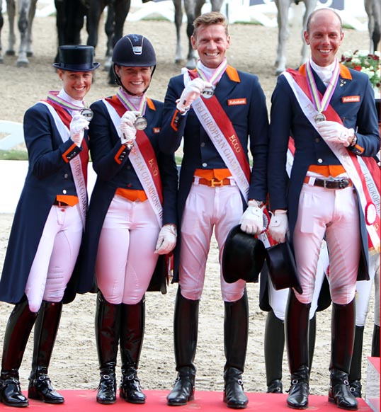 The Netherlands silver medal team of Adelinde Cornelissen, Danielle Heijkoo, Edward Gal and Hans Peter Minderhoud. © 2013 Ken Braddick/dressage-news.com