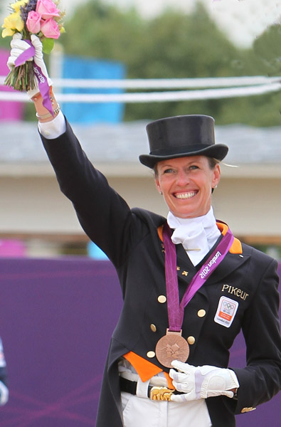 Anky van Grunsven with the team bronze medal at the London Olympic Games in 2012. ©Ken Braddick/dressage-news.com