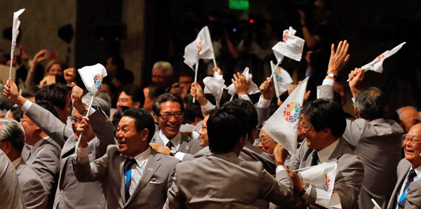 Tokyo's jubilant bid delegation after winning vote to host the 2020 Olympic Games.