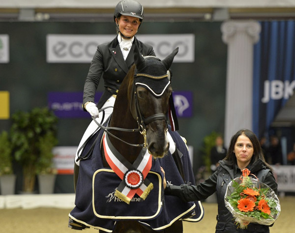 Anna Kasprzak on Donnperignon after winning Odense World Cup Grand Prix. © 2013 Ridehesten.com