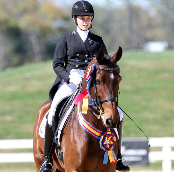 Ayden Spencer Uhir and Sjapoer enjoying championship success. © 2013 Ken Braddick/dressage-news.com