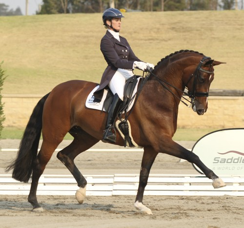 Marie Tomkinson of Victoria and her Oldenburg mare Diamantina IV win the CDI-W Grand Prix