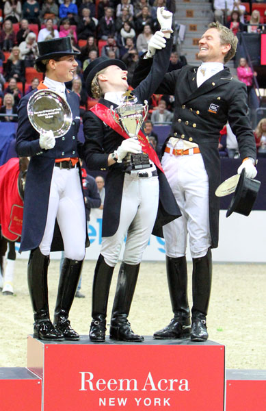 Three World Cup champions enjoying their time in the limelight on the podium at the 2013 Final--Adelinde Cornelissen (on Jerich Parzival in 2011 and 2012), Helen Langehanenberg (on Damon Hill NRW in 2013) and Edard Gal (on Totilas in 2010). © 2013 Ken Braddick/dressage-news.com